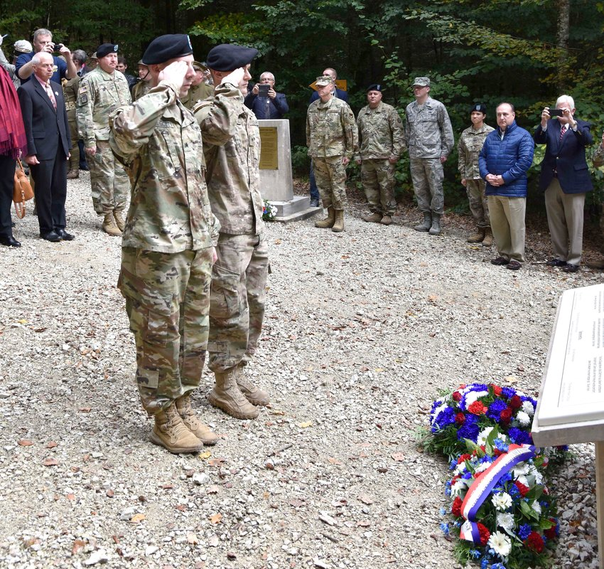 Soldiers of the Tennessee National Guard render salutes during a wreath laying at the 100th Anniversary Celebration of Tennessean Sergeant Alvin C. York's heroic actions during World War I that merited the award of the Congressional Medal of Honor near Chatel-Chéhéry, France, Oct. 7.