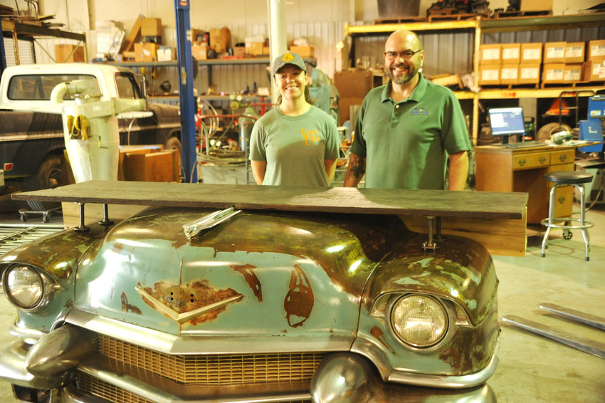 April and Brian Thiesen of Tri Star Brew Works in front of their newest kegerator. The piece which features the front end of a 1956 Cadillac will be heading to the Renaissance Marriott in Nashville.