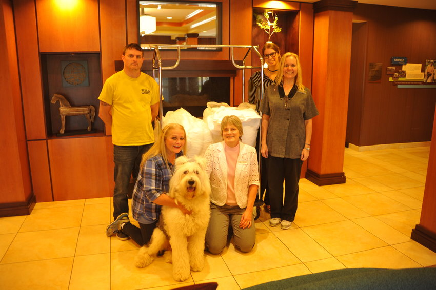 From left Nick Crosby, Cindy Bellis, Teddy, Denise Farmer, Kari Petrelis and Jennifer Patrick are those that help with donating materials from the Fairfield Inn to animal shelters in need.