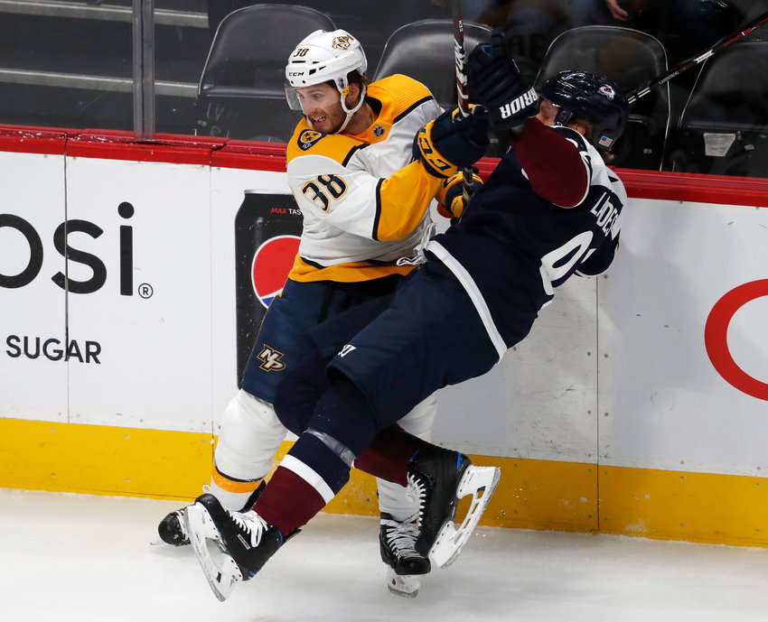 Nashville Predators right wing Ryan Hartman, left, checks Colorado Avalanche left wing Gabriel Landeskog in the first period of an NHL hockey game Wednesday, Nov. 7, 2018, in Denver. (AP Photo/David Zalubowski)