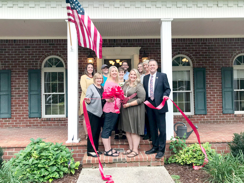 At the recent ribbon cutting for the Cookeville Estate are, from  let, front row, Dianne Callahan, Chamber VP Organizational Development; Dawn Hale;  Mady Hunley, The Cookeville Estate Director/Coordinator; and Putnam County Executive Randy Porter. On the second row, from left, are Carey Davenport, Chamber Ambassador; Tracy Hughes, Chamber Ambassador; Gabrielle Thrashers; Zach Ledbetter, Chamber VP Visitor Development; Jennifer Wheeler, Chamber Membership Coordinator; Kathy Dunn, Chamber Ambassador.