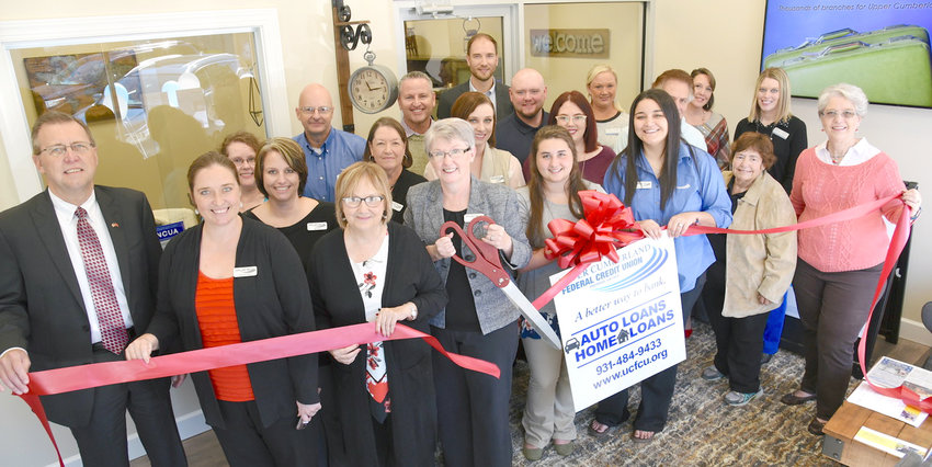 At a recent ribbon cutting for Upper Cumberland Federal Credit Union are, from left on the front row, Putnam County Executive Randy Porter; Brooke Shaffer; Dianne Callahan, Chamber VP Organizational Development; Denise Cooper, President CEO; Kali Bilbrey; Mishaela Hargis; Nancy Hyder; and Sally Oglesby. In the middle row, from left, are Mary Barnes; Shirley Bradford; Charity Parham; Kat Donaldson; Tony Brock; and Jennifer Wheeler, Chamber Membership Coordinator. In the third row, from left, are  Amy Beasley; David Robbins; Linkous Keen; Ian Robson, Chamber Ambassador; Derik Boles; Leslie Loftis, Chamber Ambassador; and Carey Davenport, Chamber Ambassador.