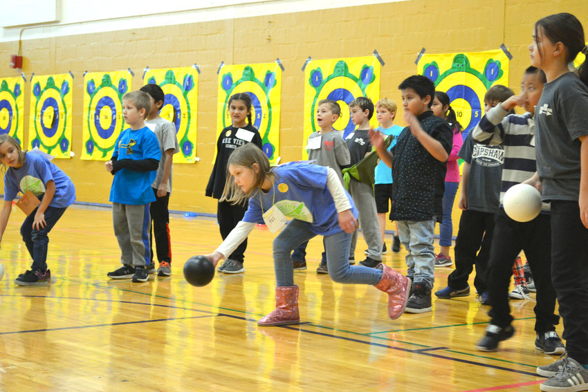 Students participate in a bowling competition at the 3rd Grade Olympics.