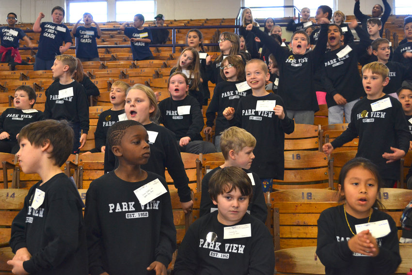"Park View third graders belt out ""We Will Rock You."""