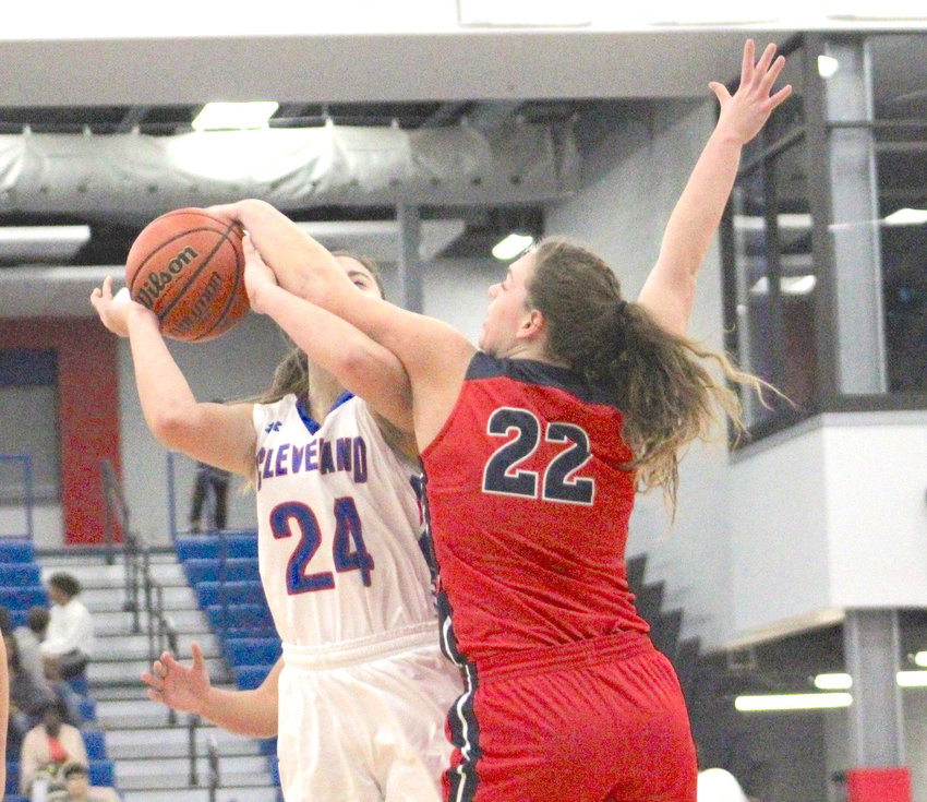 Lady Cavalier Chloe Grace Savage, right, blocks a shot during the second half of action Tuesday night.