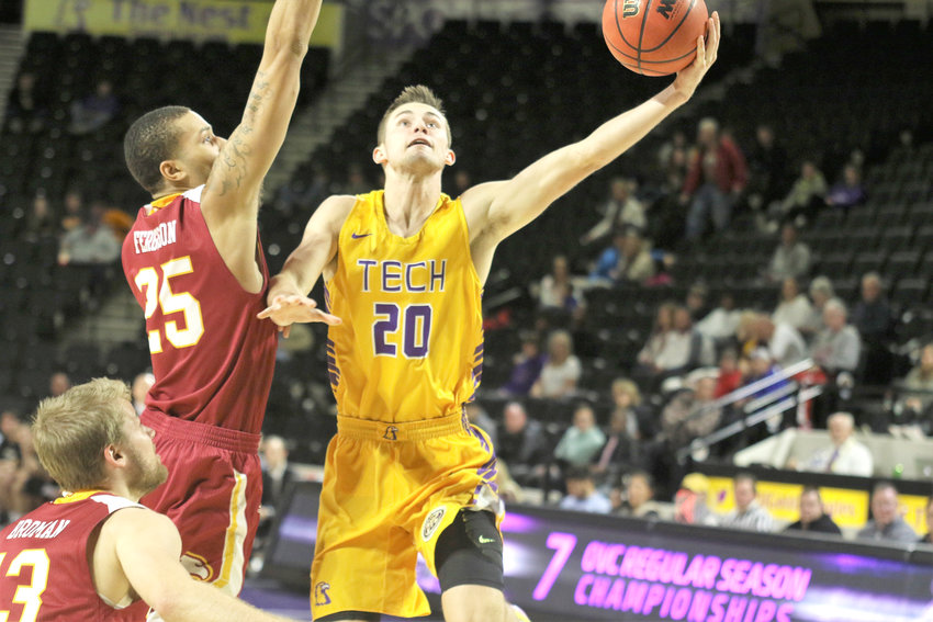 Tennessee Tech's Hunter Vick, right, goes for a layup during the Golden Eagles' 82-70 loss to Winthrop Wednesday in the Hooper Eblen Center.