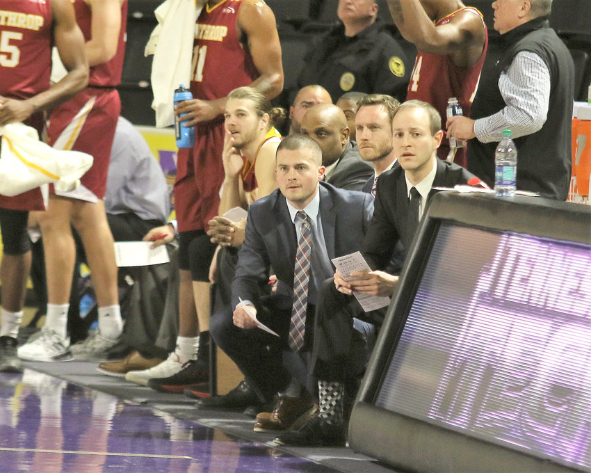 Former Cookeville High School Cavalier and Tennessee Tech Golden Eagle Mitchell Hill, center, makes his return to the Hooper Eblen Center as Winthrop's director of basketball operations Wednesday.