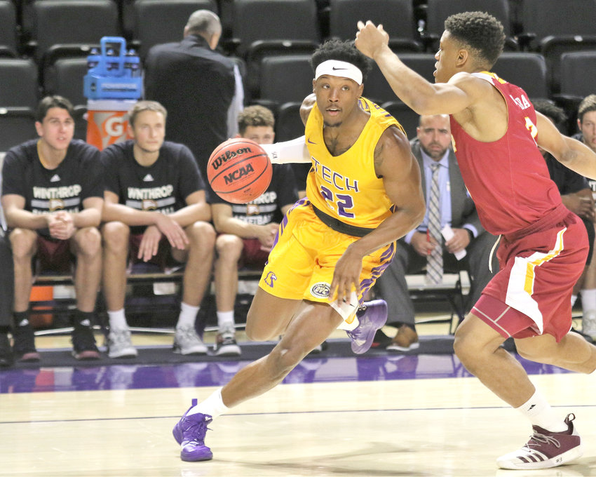 Tennessee Tech's Courtney Alexander, left, runs around a Winthrop defender during the Golden Eagles' 82-70 loss to Winthrop Wednesday in the Hooper Eblen Center.
