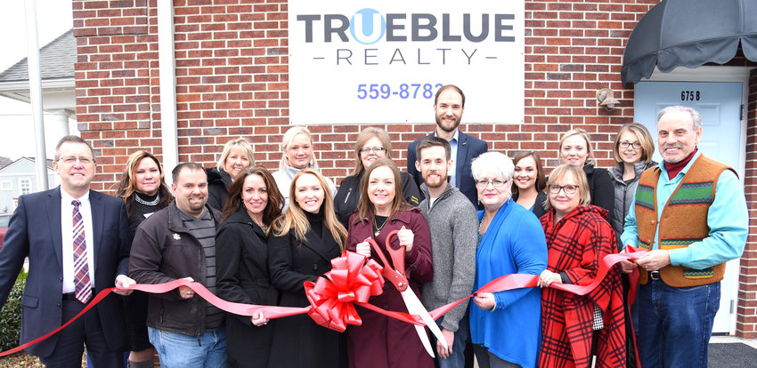 At the recent ribbon cutting for True Blue Realty were, in the front, from left, Putnam County Executive Randy Porter; Mike Farley, affiliate broker; Rachel Curtis, assistant; Virginia Kail, affiliate broker; Elaina Morgan, principal broker; Nathan Lee, affiliate broker; Evon Heady, broker Dianne Callahan, Chamber and Peter Grima, affiliate broker. In the second row, from left, Sue Swearengen, Chamber Ambassador; Kathy Dunn, Chamber Ambassador; Leslie Loftis, Chamber Ambassador; Tracy Hughes, Chamber Ambassador; Ian Robson, Chamber Ambassador; Amber Kincaid; Whitley Garrett and Kristin Morgan.