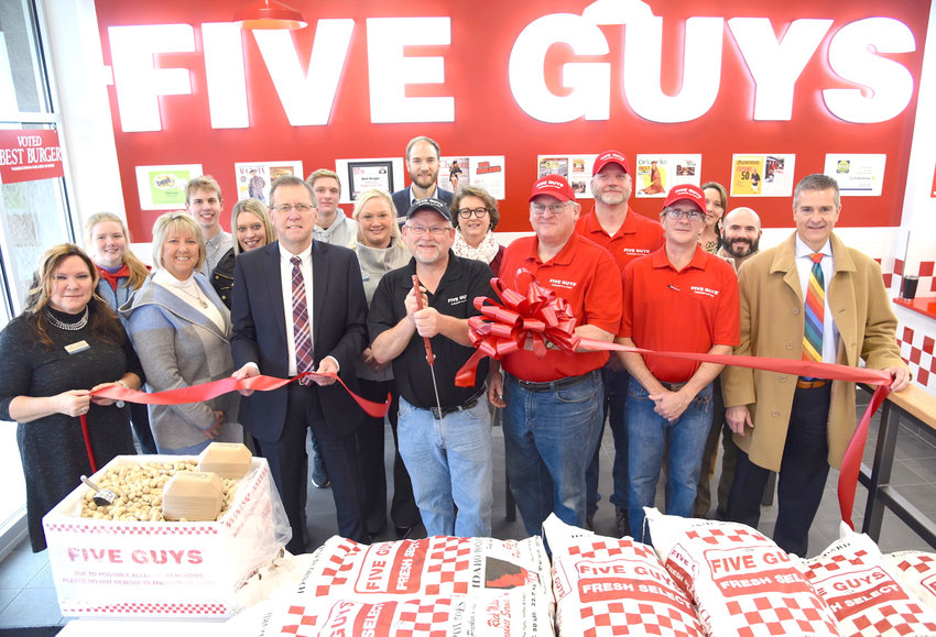 At the recent ribbon cutting for Cookeville's new Five Guys restaurant are, from left, front row, Sue Swearengen, Chamber Ambassador; Kathy Dunn, Chamber Ambassador; Putnam County Executive Randy Porter; Chuck Davidson, General Manager; Jim Richards, Owner ; Rodney Hutson, Area Supervisor and Mayor Ricky Shelton. On the second row, from left, are Maura Hart; Ryan Heap; Jennifer Wheeler, Chamber Membership Coordinator; Carson Pletcher; Leslie Loftis, Chamber Ambassador; Ian Robson, Chamber Ambassador; Becky Hull, Chamber Ambassador; Bruce Bowman, Director of Operations; Carey Davenport, Chamber Ambassador; Brandon Parrish, Chamber Ambassador.
