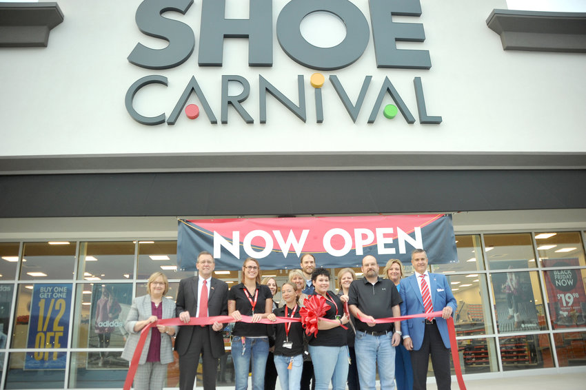 Shoe Carnival held their grand opening Nov. 8 at the Shoppes at Eagle Point. Front row from left, Diane Callahan, Cookeville Chamber, Randy Porter, Putnam County Executive, Jenifer Holman, Shoe Carnival, Joni Summers, Shoe Carnival, Tiffany Neal, Shoe Carnival general manger, Mark Allen, general manager of Murfreesboro Shoe Carnival, Ricky Shelton, Cookeville mayor. Back row, Toni Evans, America Bank and Trust, Kathy Dunn, Cookeville Chamber, Ian Robson, First Bank, Tracy Hughes, Chamber ambassador, and Jenifer Guerrero, Chamber ambassador.