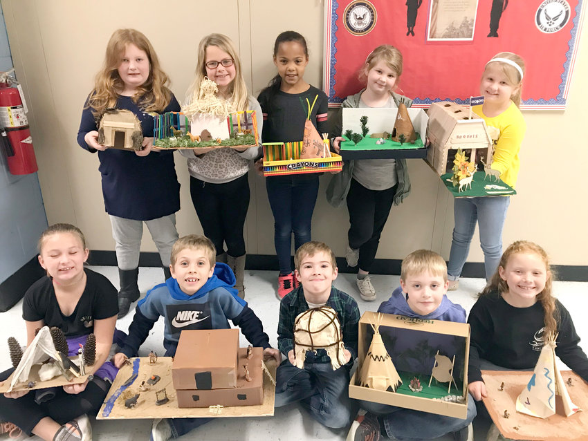 Sycamore students recently made models of various styles of Native American homes during a recent history lesson. From left, front row, are  Righ-Alyssa Driller, Elijah Elliot, Kaden Render, Bentley Ramsey and Kylie Brooks. On the second row, from left, are Abbie Choate, Aubree Pryor, Savannah Walker, Callie Burcham and Taylor Powers.