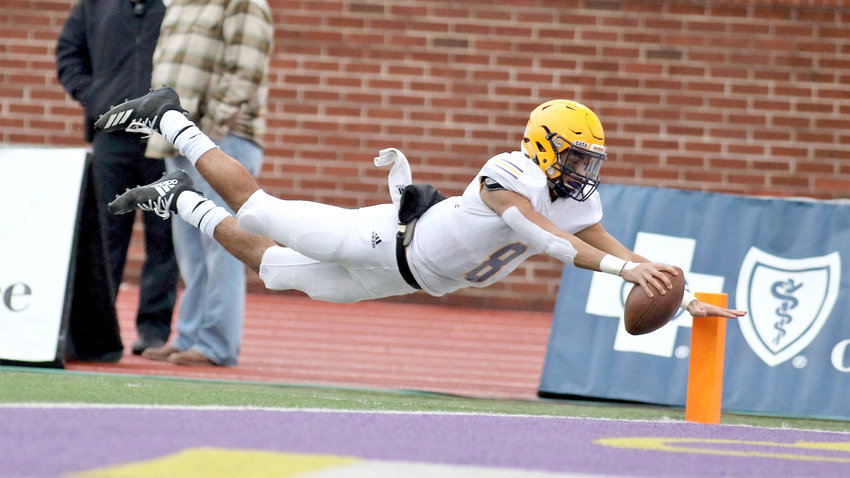 Trousdale County's Keyvont Baines dives for a touchdown during action Thursday in the first round of the BlueCross Bowl at Tennessee Tech. The Yellow Jackets lost the 2A title game to Peabody.