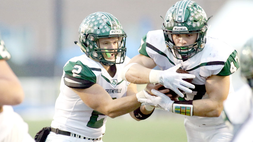 Greeneville quarterback Cade Ballard hands off to Ty Youngblood during action Thursday in the BlueCross Bowl.