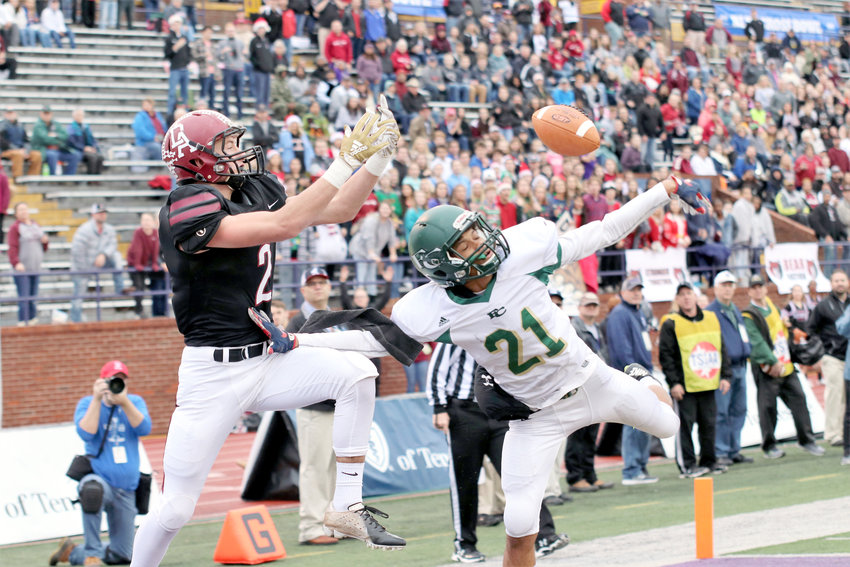 Davidson  Academy's Jared Vetetoe, left, reaches for a pass over the hands of Friendship Christian's Dorian Champion during Friday's Division II, 1A championship game.