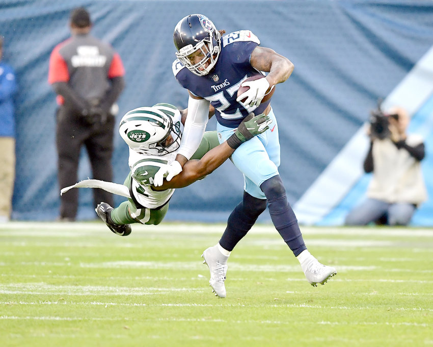 New York Jets inside linebacker Avery Williamson (54) tries to hang onto Tennessee Titans running back Derrick Henry (22) during the first half of an NFL football game on Sunday, Dec. 2, 2018, at Nissan Stadium in Nashville, Tenn. The Titans win 26-22. (Photo by Lee Walls)