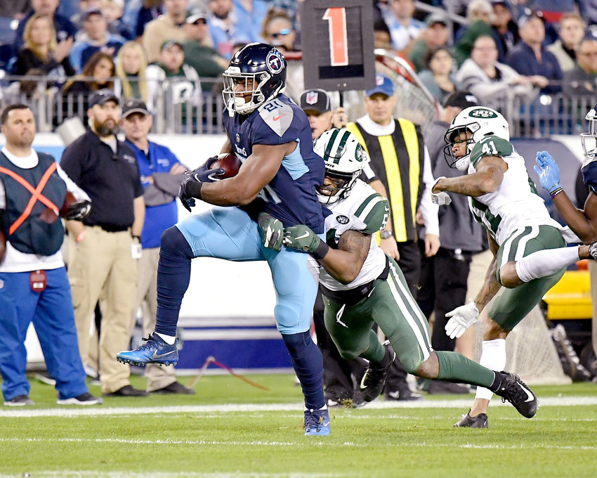 Tennessee Titans tight end Jonnu Smith (81) tries to shake a New York Jets player during the second half of an NFL football game on Sunday, Dec. 2, 2018, at Nissan Stadium in Nashville, Tenn. The Titans win 26-22. (Photo by Lee Walls)