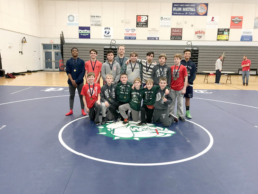 Celebrating their first-place medals from Tuesday night's Cookeville City Wrestling Championships at Prescott South Middle School are (front row, from left) Connor Blaylock, Trenton Houston, James Strong, Donald Mahaney, Timmy Sneed, Jonah Bray, (Back row, from left) Jourdyn Burruss, Jacob Watkins, Mason Allen, Josh Anderson, Greyson Dennis, Aniceto Szotck, Nick Canfield, Ethan Lane, and Eziah Peek.