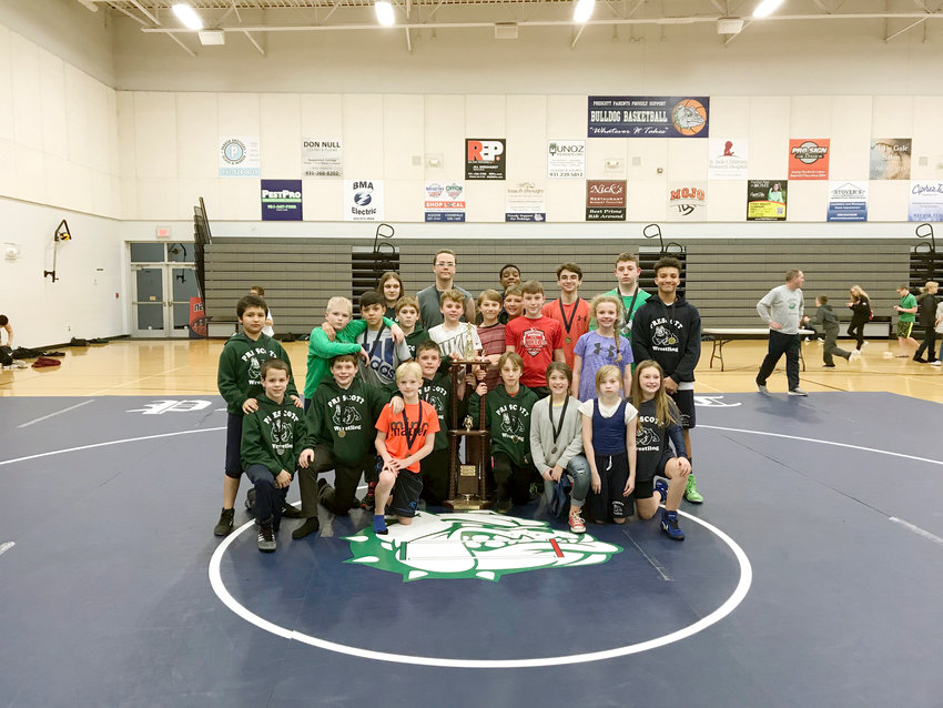 The Prescott South Middle School wrestling team celebrates its Cookeville City Wrestling Championship Tuesday night at PSMS.