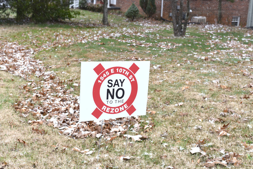 Numerous signs have been posted in yards along East 10th Street and Old Kentucky Road in opposition of the rezoning for a proposed shopping center. The city council is expected to consider the rezoning of 1545 E. 10th St. from single-family residential to planned commercial development at its Jan. 3 meeting.