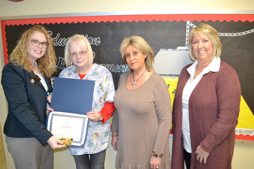 Rose Daniels is the December Rotary Student of the Month at the Adult High School. From left, Rotary Sunset President Tessa Lawson, Daniels, and Rotary members Debbie Graham and Kathy Dunn.