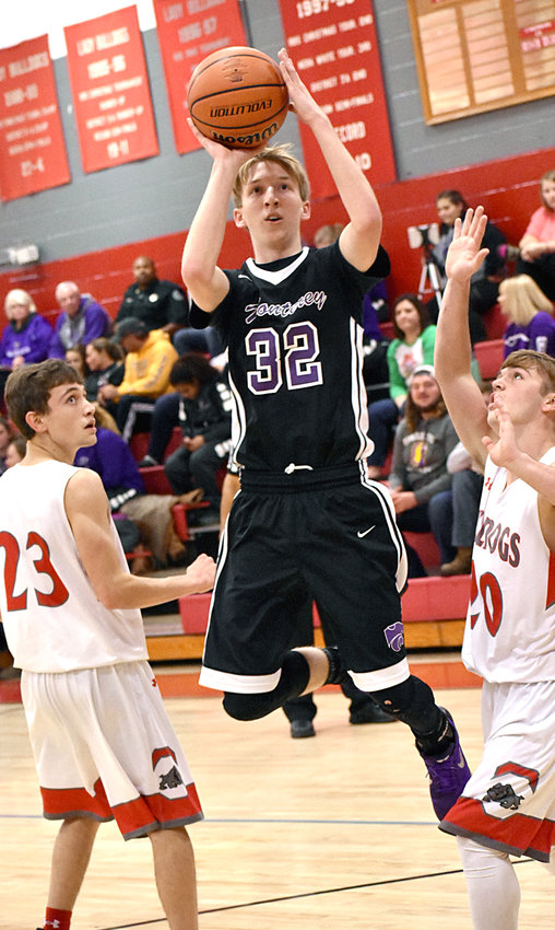 Jaxson Billings shoots from the lane during action Friday night