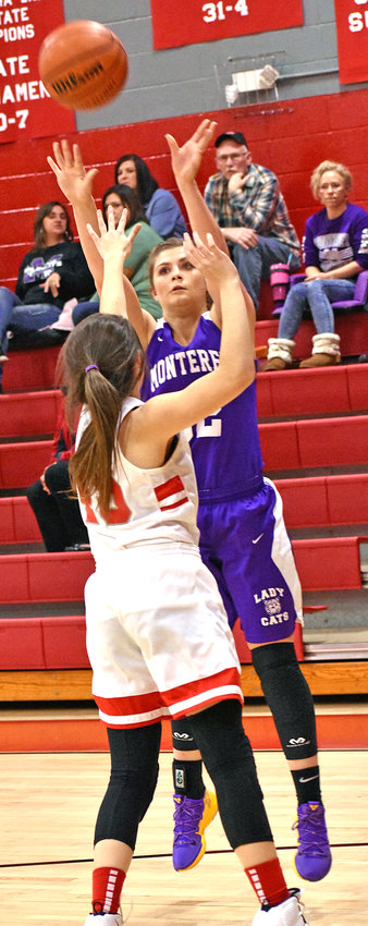 Monterey's Anna Hudson, right, shoots over a Gordonsville defender during the Lady Wildcats' 62-58 loss Tuesday at GHS.