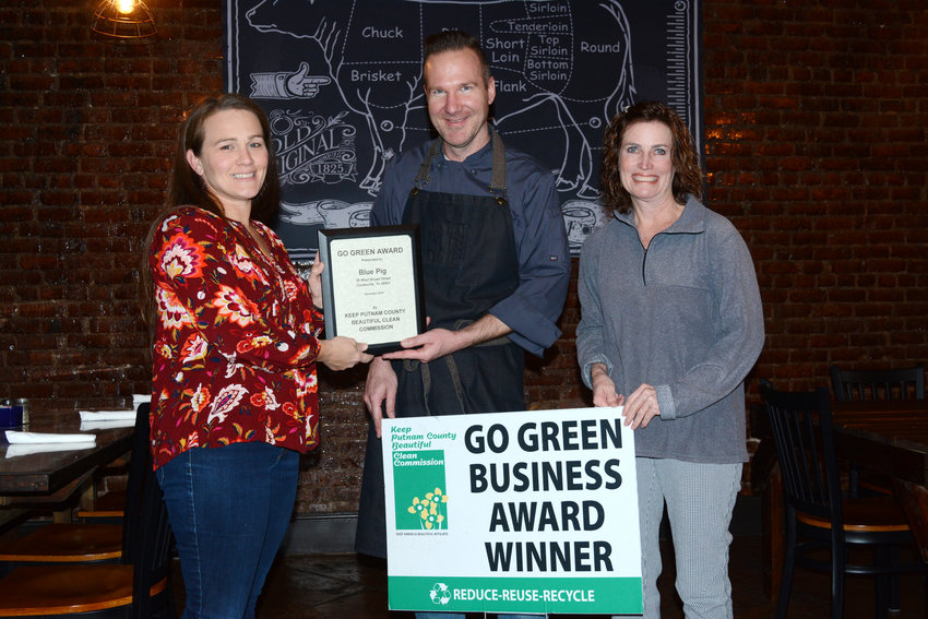 The Blue Pig received the Putnam County Clean Commission's Go Green award for December. The Blue Pig is working to reduce their use of plastics, aluminum and styrofoam in the kitchen, and with customers. They have chosen biodegradable to-go containers, cups and straws, eliminating styrofoam use. They have a policy to hand out straws only at the request of customers since a recent study showed that Americans throw away over 500 million straws per day. From left are Kristen Mattson with the Putnam County clean commission, Kent Bridwell, owner and chef of the Blue Pig, and Shannon Reese, executive coordinator for the Putnam County clean commission.