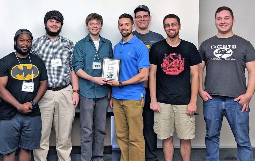Celebrating a second-place showing at The Collegiate Penetration Testing Competition regionals at Missouri S&T are Tennessee Tech team penetration team members (from left) Darren Cunningham, Sam Wehunt, captain Joe Bivens, coach Joseph Cross, Max Layer, David Yantis and Connor Gannon.