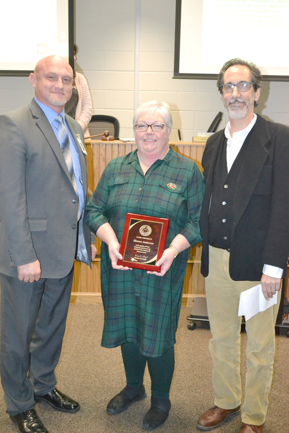 Bryan Symphony Orchestra conductor Dan Allcott nominated Dr. Sharon Anderson for an I Make A Difference award, recognizing her assistance in providing a symphony concert experience to fourth graders. From left, Director of Schools Jerry Boyd, Anderson and Allcott.