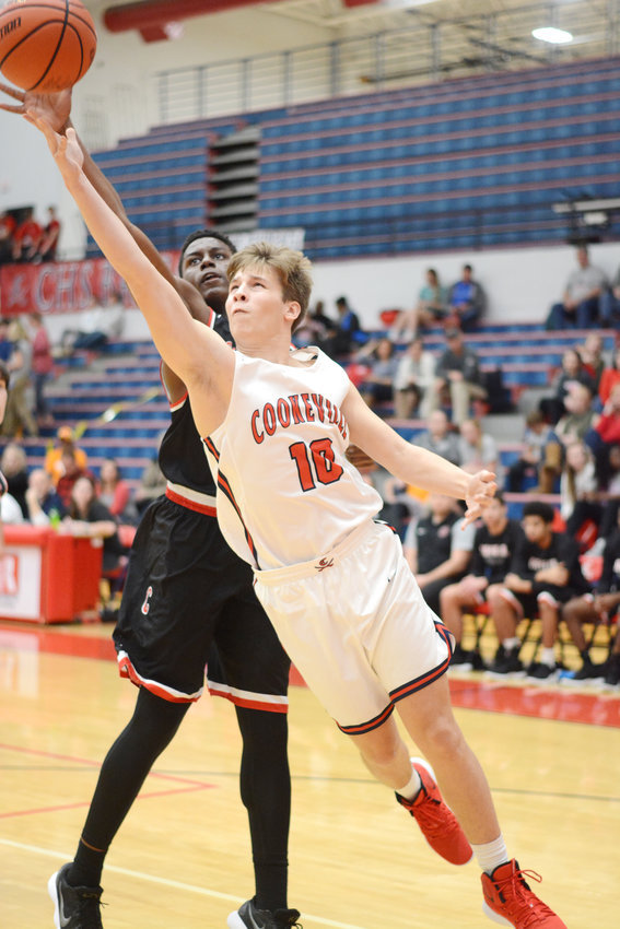 Cookeville's Bailey Gilliam, front, reaches for a layup during the Cavs' 78-46 win over Coffee County Friday night at CHS.