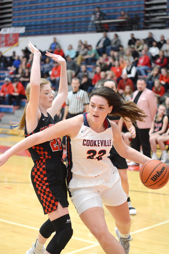 Cookeville's Chloe Grace Savage, right, drives the baseline during the Lady Cavs' 66-56 loss to Coffee County Friday night at CHS.