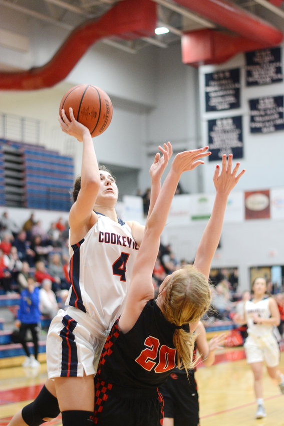 Cookeville's Olivia Shipman, left, elevates for a floater during the Lady Cavs' 66-56 loss to Coffee County Friday night at CHS.