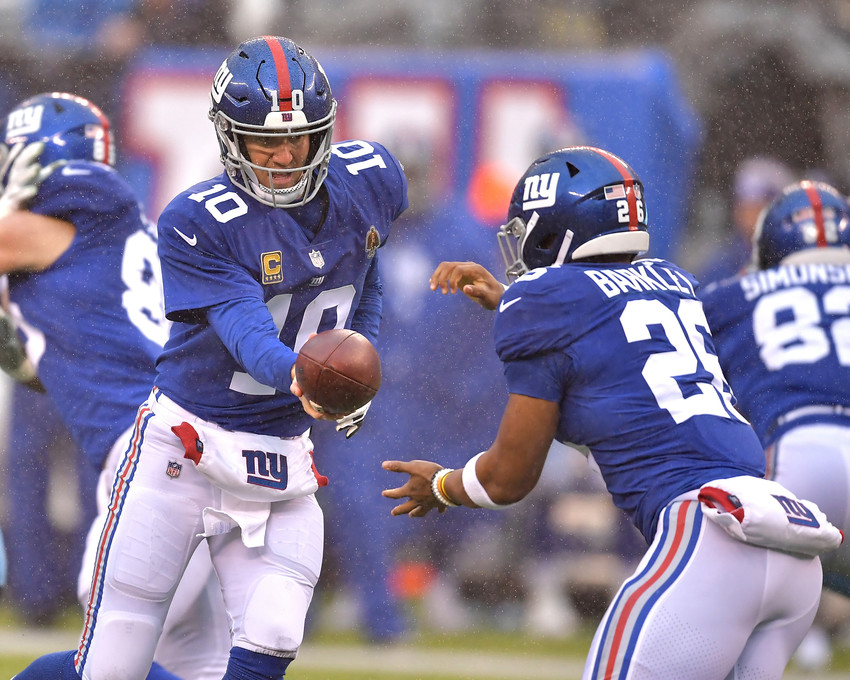 New York Giants quarterback Eli Manning (10) hands off the ball to New York Giants running back Saquon Barkley (26) during the first half of an NFL football game against the Tennessee Titans, Sunday, Dec. 16, 2018, at MetLife Stadium in East Rutherford, N.J. The Titans win 17-0. (Photo by Lee Walls)