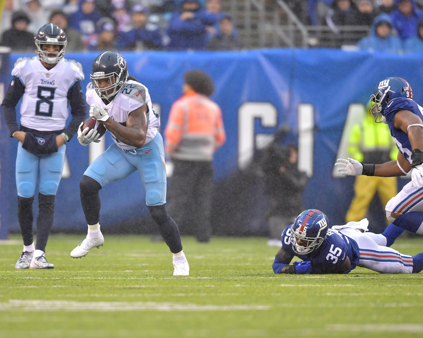 New York Giants free safety Curtis Riley (35) is left in the wake of Tennessee Titans running back Derrick Henry (22) during the first half of an NFL football game, Sunday, Dec. 16, 2018, at MetLife Stadium in East Rutherford, N.J. The Titans win 17-0. (Photo by Lee Walls)