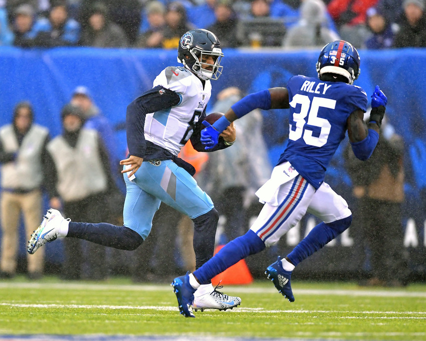Tennessee Titans quarterback Marcus Mariota (8) with a keeper for a first down in the first half of an NFL football game against the New York Giants, Sunday, Dec. 16, 2018, at MetLife Stadium in East Rutherford, N.J. The Titans win 17-0. (Photo by Lee Walls)