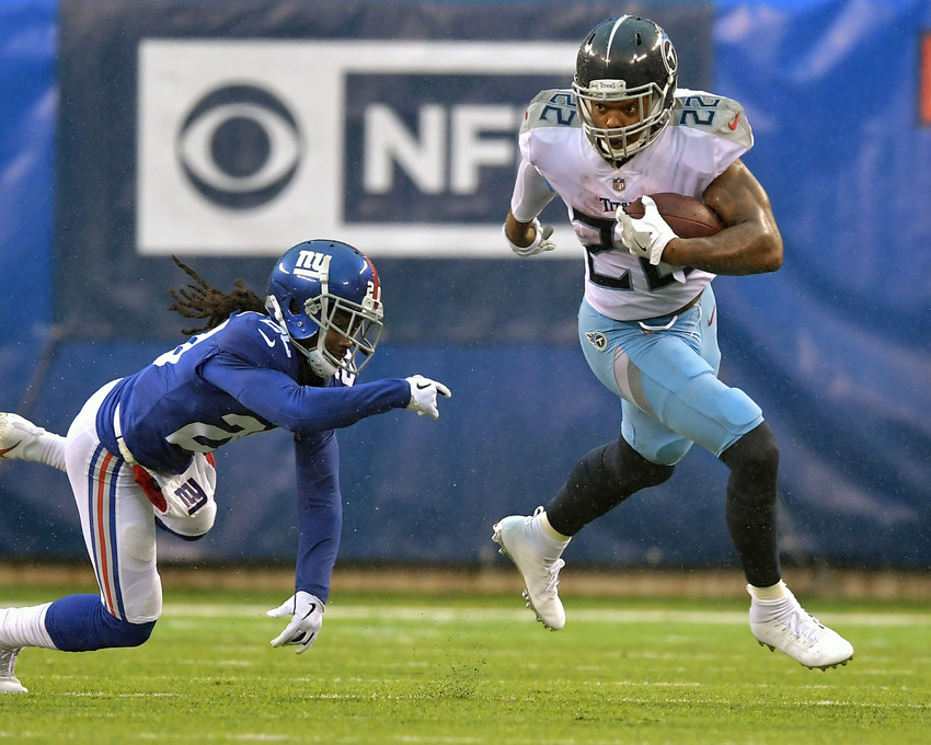 Tennessee Titans running back Derrick Henry (22) gets around the edge on his way to a first down during the first half of the New York Giants versus Titans NFL football game, Sunday, Dec. 16, 2018, at MetLife Stadium in East Rutherford, N.J. The Titans win 17-0. (Photo by Lee Walls)