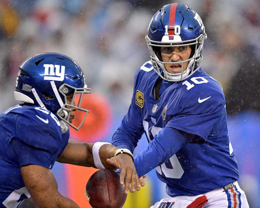 New York Giants quarterback Eli Manning (10) hands the ball off to running back Saquon Barkley (26) during the first half of an NFL football game, Sunday, Dec. 16, 2018, at MetLife Stadium in East Rutherford, N.J. The Titans win 17-0. (Photo by Lee Walls)