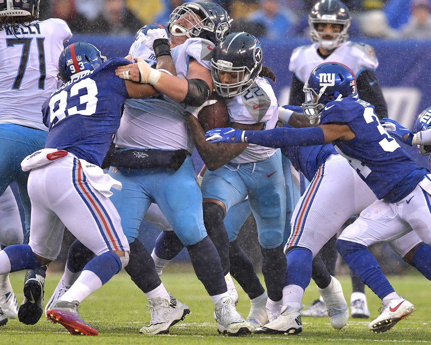 Tennessee Titans running back Derrick Henry (22) finds an opening in the line during the first half of the New York Giants versus Titans NFL football game, Sunday, Dec. 16, 2018, at MetLife Stadium in East Rutherford, N.J. The Titans win 17-0. (Photo by Lee Walls)
