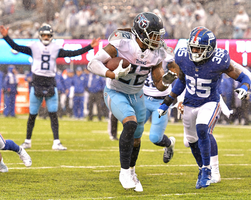 Tennessee Titans quarterback Marcus Mariota (8) signals touchdown as running back Derrick Henry (22) heads for the end zone during the second half of the New York Giants versus Titans NFL football game, Sunday, Dec. 16, 2018, at MetLife Stadium in East Rutherford, N.J. The Titans win 17-0. (Photo by Lee Walls)