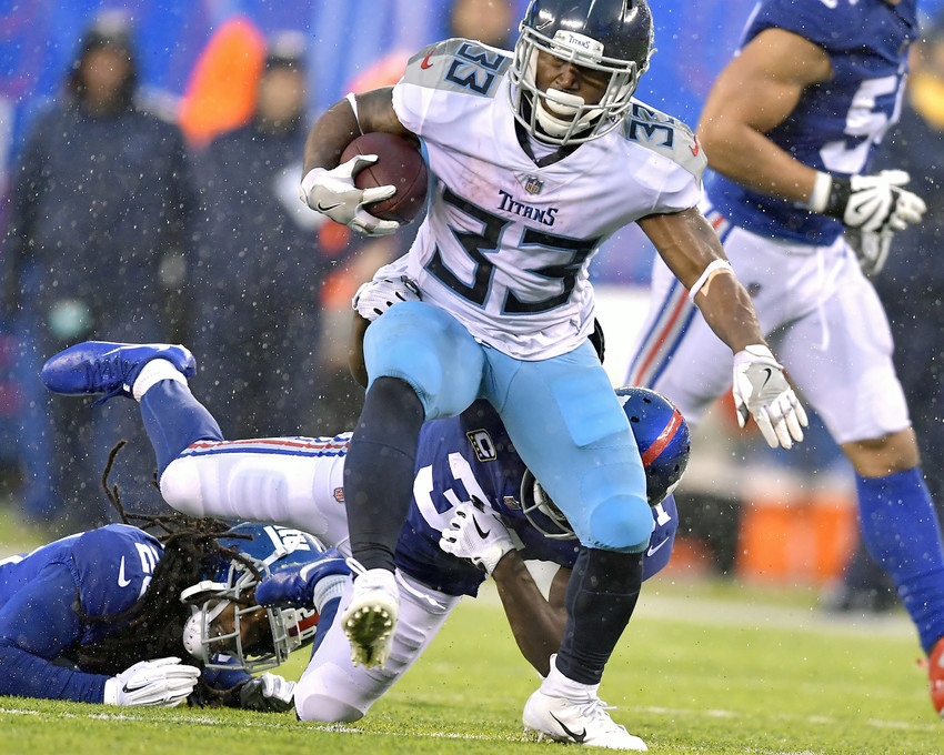 Tennessee Titans running back Dion Lewis (33) gets around the edge and turns upfield during the second half of the New York Giants versus Titans NFL football game, Sunday, Dec. 16, 2018, at MetLife Stadium in East Rutherford, N.J. The Titans win 17-0. (Photo by Lee Walls)