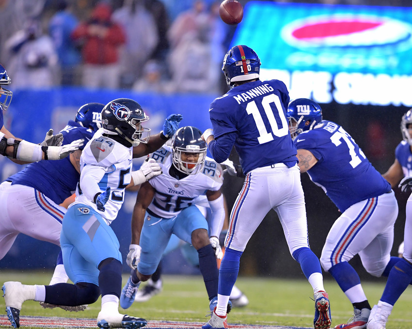New York Giants quarterback Eli Manning (10) throws under pressure during the second half of the Giants versus Tennessee Titans NFL football game, Sunday, Dec. 16, 2018, at MetLife Stadium in East Rutherford, N.J. The Titans win 17-0. (Photo by Lee Walls)
