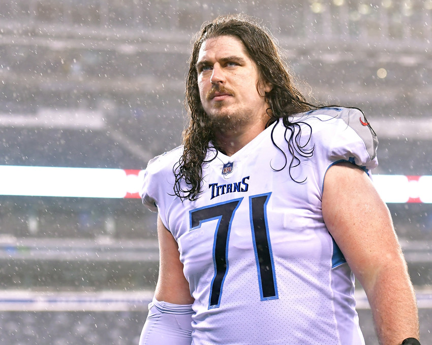 Tennessee Titans offensive tackle Dennis Kelly (71) leaves a soggy field following the New York Giants versus Titans NFL football game, Sunday, Dec. 16, 2018, at MetLife Stadium in East Rutherford, N.J. The Titans win 17-0. (Photo by Lee Walls)