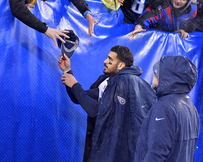 Tennessee Titans quarterback Marcus Mariota (8) hands a cap to a fan following the Titans versus New York Giants NFL football game, Sunday, Dec. 16, 2018, at MetLife Stadium in East Rutherford, N.J. The Titans win 17-0. (Photo by Lee Walls)