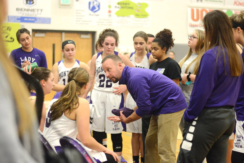 Monterey's Mark Simms, center, gives instruction to his team during the Lady Wildcats' 78-34 loss to DeKalb County Tuesday at MHS.