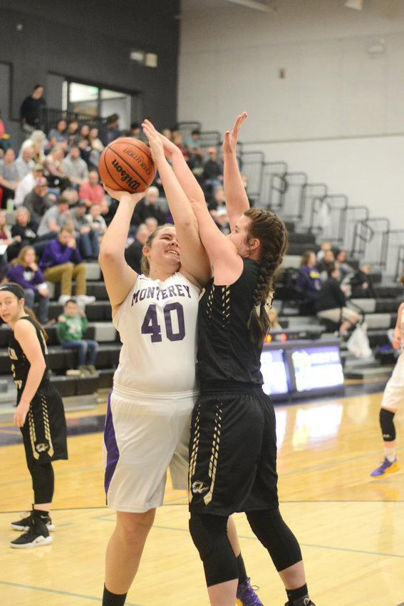 Monterey's Grace Clouse, left, puts up a shot during the Lady Wildcats' 78-34 loss to DeKalb County Tuesday at MHS.