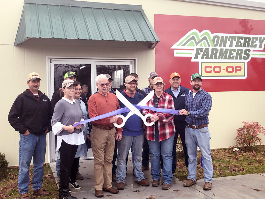 At the recent ribbon cutting for the Monterey Farmers Coop at 202 S. Holly St. in Monterey were, from left, front row, Deb Dunn, White County Co-Op manager, Julie Bohannon, Town of Monterey cultural administrator, Mayor Bill Wiggins, Aaron Pittman, Kaydee Johnston, and David Simmons, agronomony specialist. On the second row, from left, are Ben Clark, White County Co-Op board president, Mark Davis, BonoKeyes, Andrew Baisley, Cumberland County Co-Op, Ray Lyons, and Rick Syler, Tennessee Farmers Co-Op seed specialist.