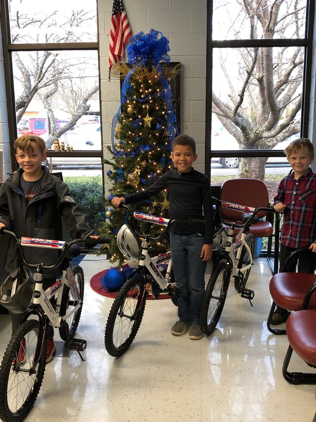 These Sycamore Elementary students were three of 30 Putnam County schools students to receive free bikes for Christmas from Academy Sport + Outdoors delivered by Cookeville police and firefighters. From left are Tristen McWhirter, Maddux Barnes and Cameron Shockley.