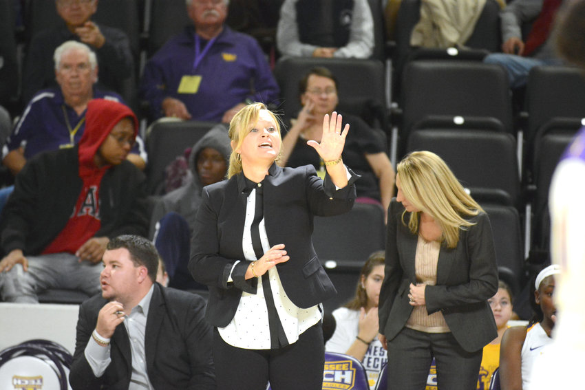 Tennessee Tech women's head coach Kim Rosamond gives instruction during a recent game against MTSU at the Hooper Eblen Center.