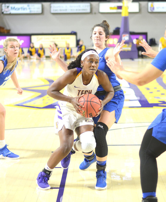 Tennessee Tech's Kesha Brady, center, drives the lane during a recent game against MTSU at the Hooper Eblen Center.